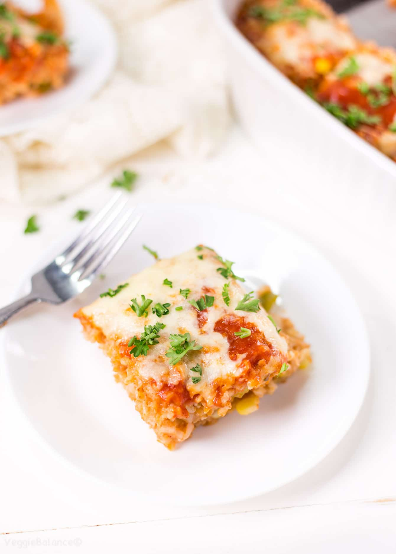 Enchilada Rice Casserole in white casserole dish