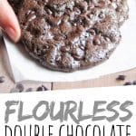 """PINTEREST IMAGE with words """"Flourless Double Chocolate Chip Cookies"""" Flourless Double Chocolate Chip Cookies being lifted off a pile."""