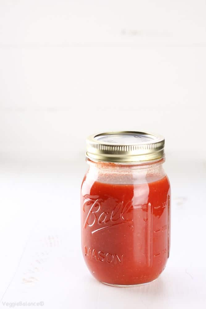Homemade Buffalo Sauce in Mason Jar with white background