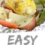 """PINTEREST IMAGE with words """"Easy Hobo Dinner"""" Easy Hobo Dinner with corn cob, carrots, potatoes, and peppers."""