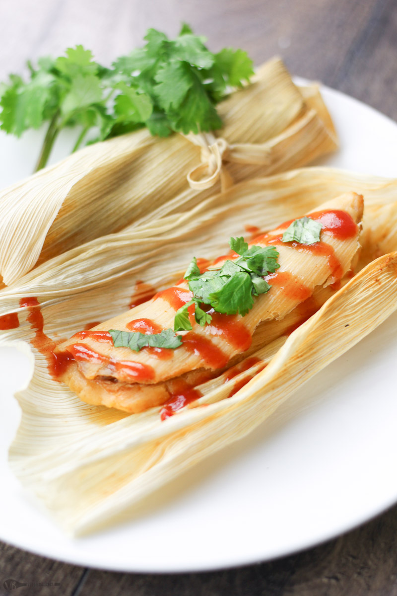 Easy Pork Tamales recipe. How to make tamales at home, and it's easier than you may think. Classic Mexican holiday dish that takes a good amount of time to make, but totally worth it once you bite into a fresh tamale right out of the steamer. We will show you how to easily make these using the slow-cooker, how to wrap the tamales, and how to steam them too. (Gluten-Free & Dairy-Free)