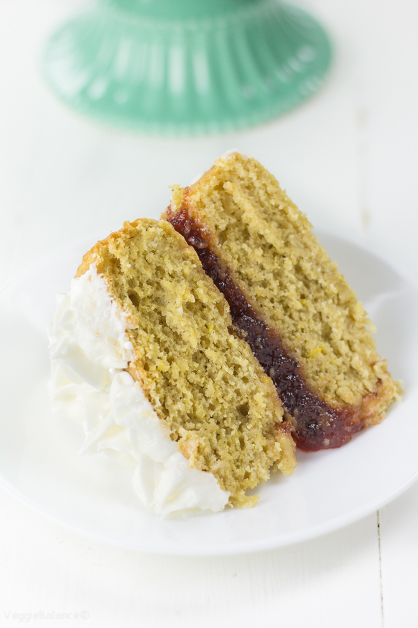 Gluten-Free Lemon Jelly Cake recipe made a little bit healthier with a low-sugar moist lemon cake and a Naked Cake frosting style helping to cut down on that extra frosting but still with all the delicious lemon and strawberry flavor. (Gluten-Free, Dairy-Free, Vegan Friendly)