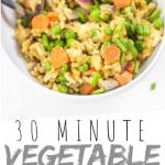 "PINTEREST IMAGE with words ""30 minute vegetable fried rice"" vegetable fried rice in a white bowl"