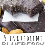 """PINTEREST IMAGE with words """"5 ingredient Blueberry No Bake Protein Bars"""" Blueberry No Bake Protein Bars in a bowl with one on top with a corner bitten off"""