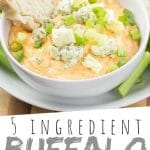 "PINTEREST IMAGE with words ""5 ingredient Buffalo Chicken Dip"" Buffalo Chicken Dip with green onion and blue cheese crumble on top in a white bowl with a slice of bread sticking out."