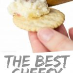 """PINTEREST IMAGE with words """"The Best Cheesy Horseradish Cracker Dip"""" Cheesy Horseradish Cracker Dip being spread on a cracker"""