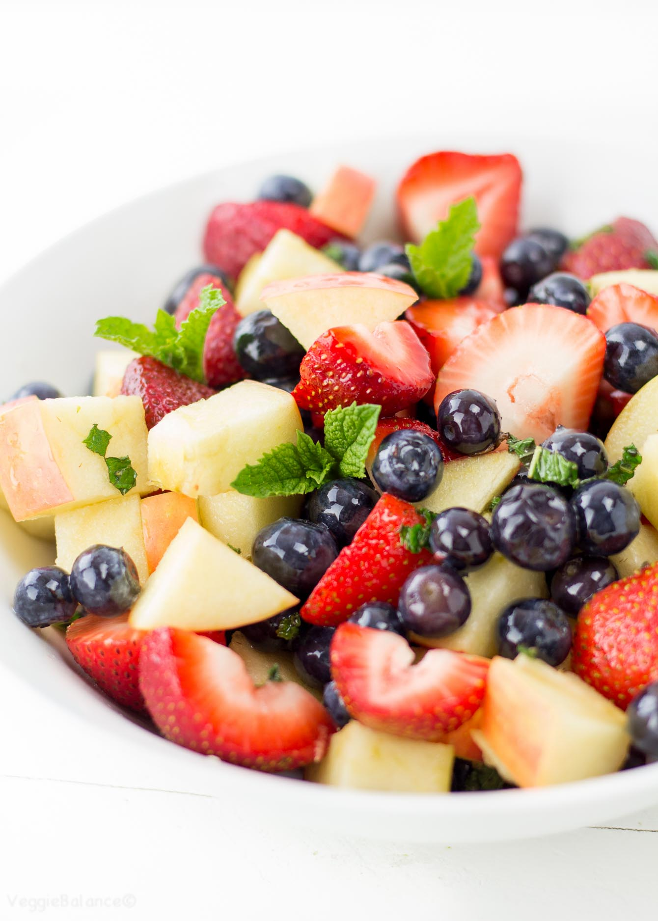 Lemon Mint Fruit Salad (aka The Red, White & Blue Fruit Salad) Toss strawberries, blueberries and apples together then drizzle with a homemade fresh lemon mint dressing. So simple but so delicious. (Gluten Free, Dairy Free, Vegan)