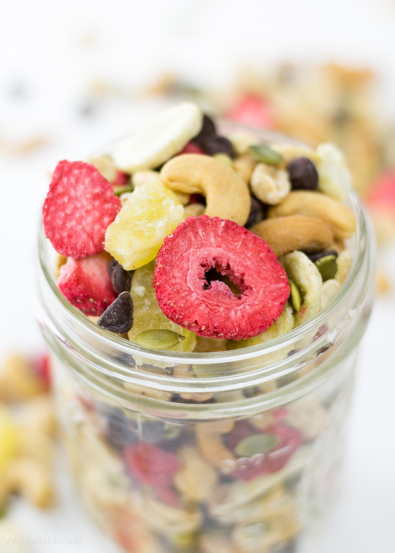 Banana Split Trail Mix recipe featuring 7 easy ingredients including dried bananas, strawberries, pineapple, cashews, peanuts, pumpkins seeds and of course chocolate! A travel snack you'll want for now on. (Gluten Free, Dairy Free, Vegan)