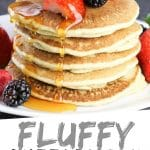 """PINTEREST IMAGE with words """"Fluffy Buttermilk Pancakes"""" Fluffy Buttermilk Pancakes stacked with strawberries and blackberries and syrup being poured over top"""