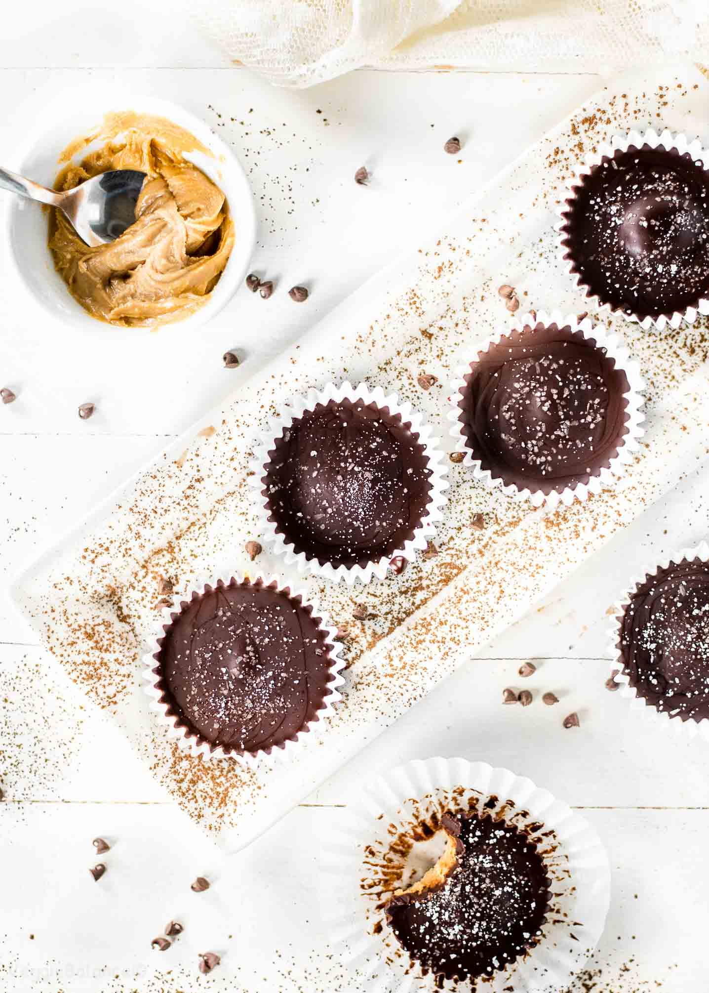 Homemade Peanut Butter Cups Overhead with Cup of Peanut Butter and Cocoa Powder