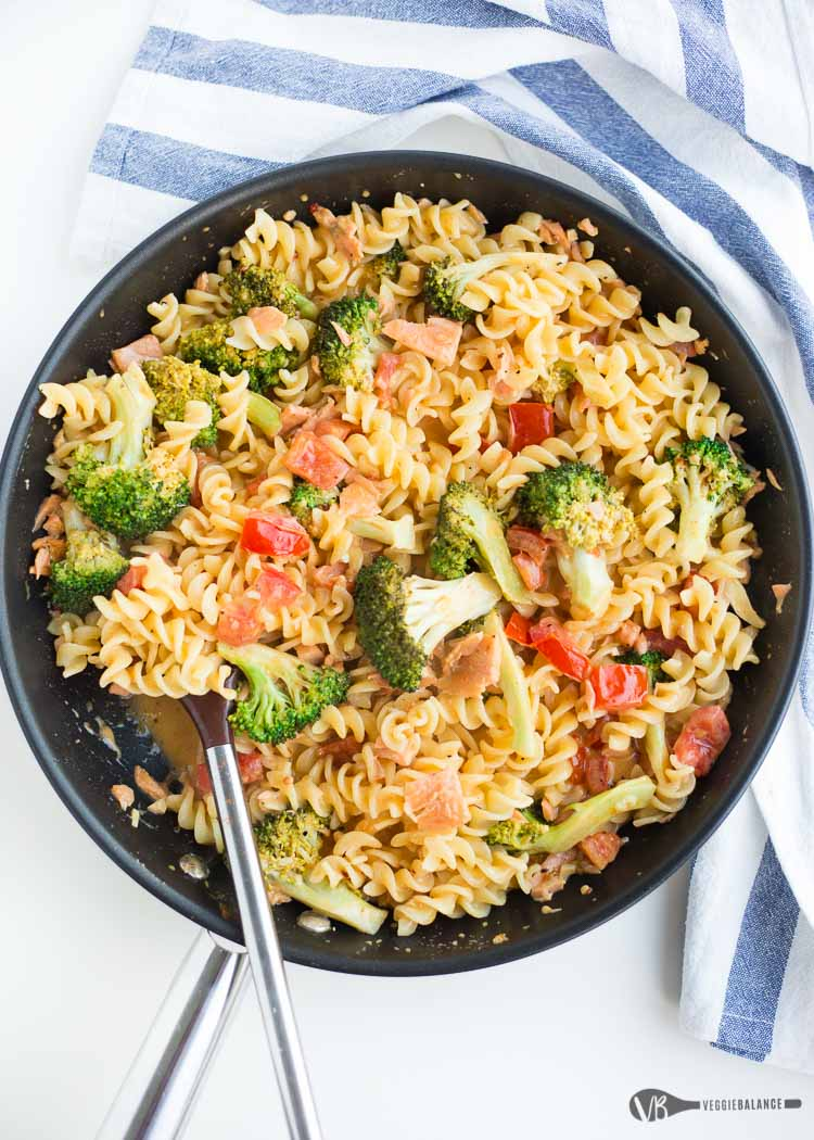 Salmon Cajun Pasta in a skillet with broccoli