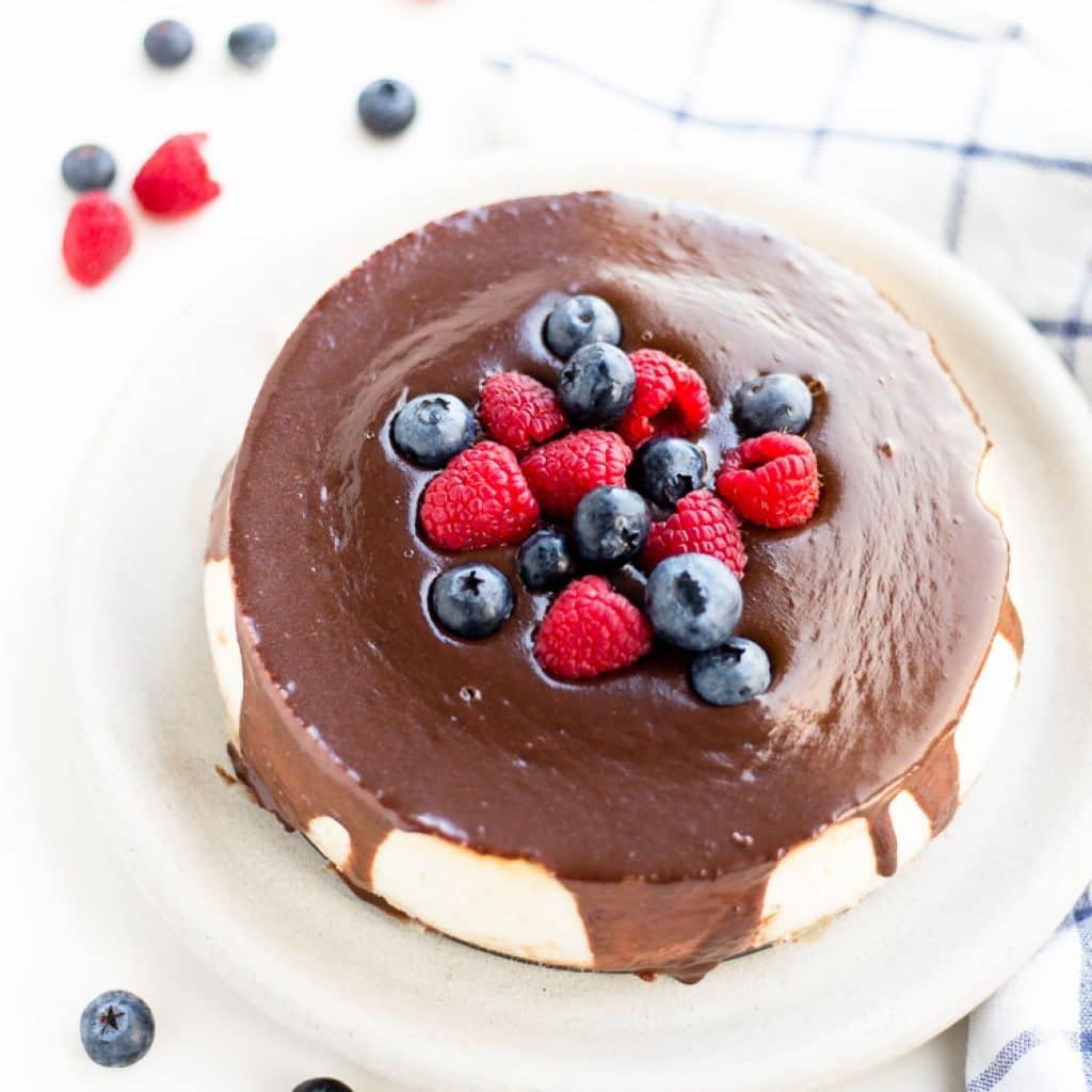 Gluten Free Cheesecake with chocolate and berries on top