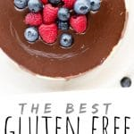 """PINTEREST IMAGE with words """"The Best Gluten Free Cheesecake"""" Gluten Free Cheesecake with chocolate and berries on top"""