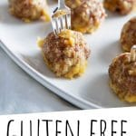 "PINTEREST IMAGE with words ""Gluten Free Meatballs"" Gluten Free Meatballs with small forks sticking out the top on a white dish"