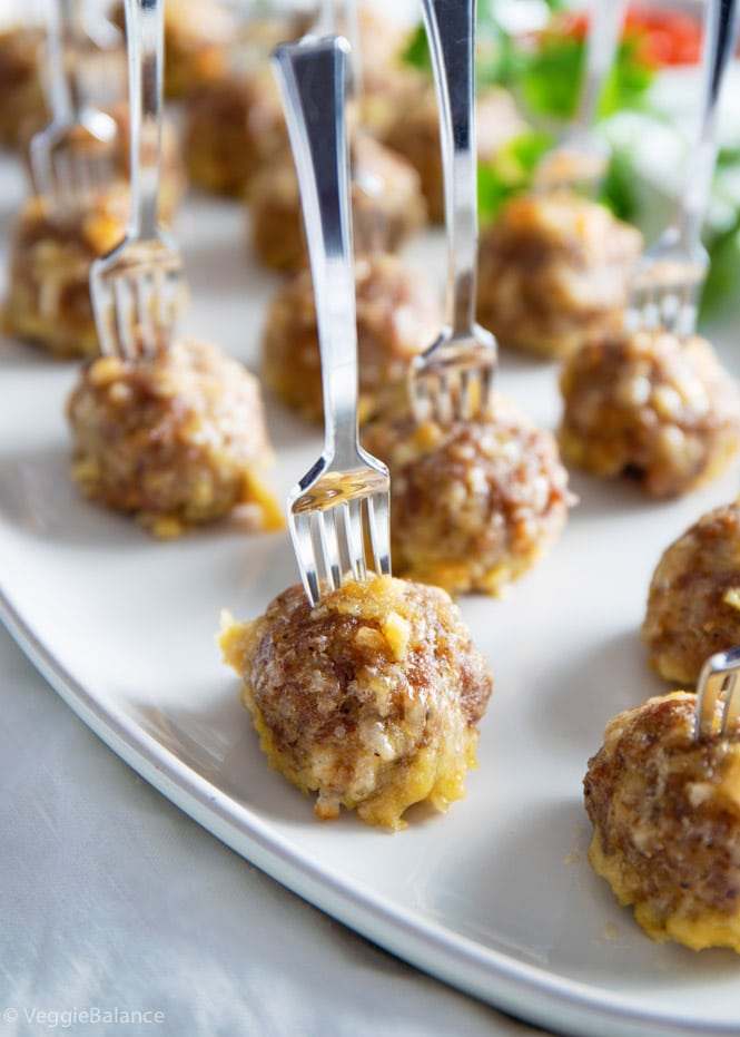 Gluten Free Meatballs with small forks sticking out the top on a white dish