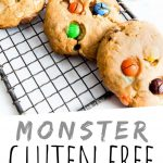 """PINTEREST IMAGE with words """"Monster Gluten Free Cookies"""" Gluten Free Monster Cookies with M&M's on a cooling rack"""