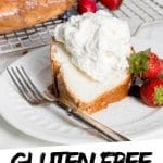 """PINTEREST IMAGE with words """"Gluten Free Angel Food Cake"""" Gluten Free Angel Food Cake slice on a whipped cream on top and strawberries."""