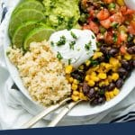 """PINTEREST IMAGE with words """"Plant Based Burrito Bowl"""" Overhead shot of Easy Vegan Burrito Bowl in a white bowl"""