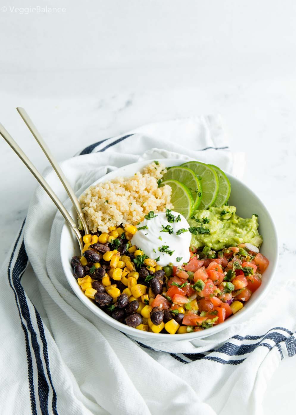 Easy Vegan Burrito Bowl with sour cream, cilantro lime quinoa