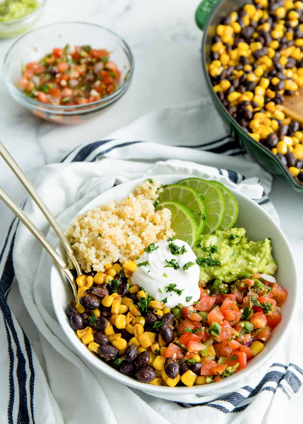 Easy Vegan Burrito Bowl built and with leftover pico de gallo and black bean mixture for extra meals