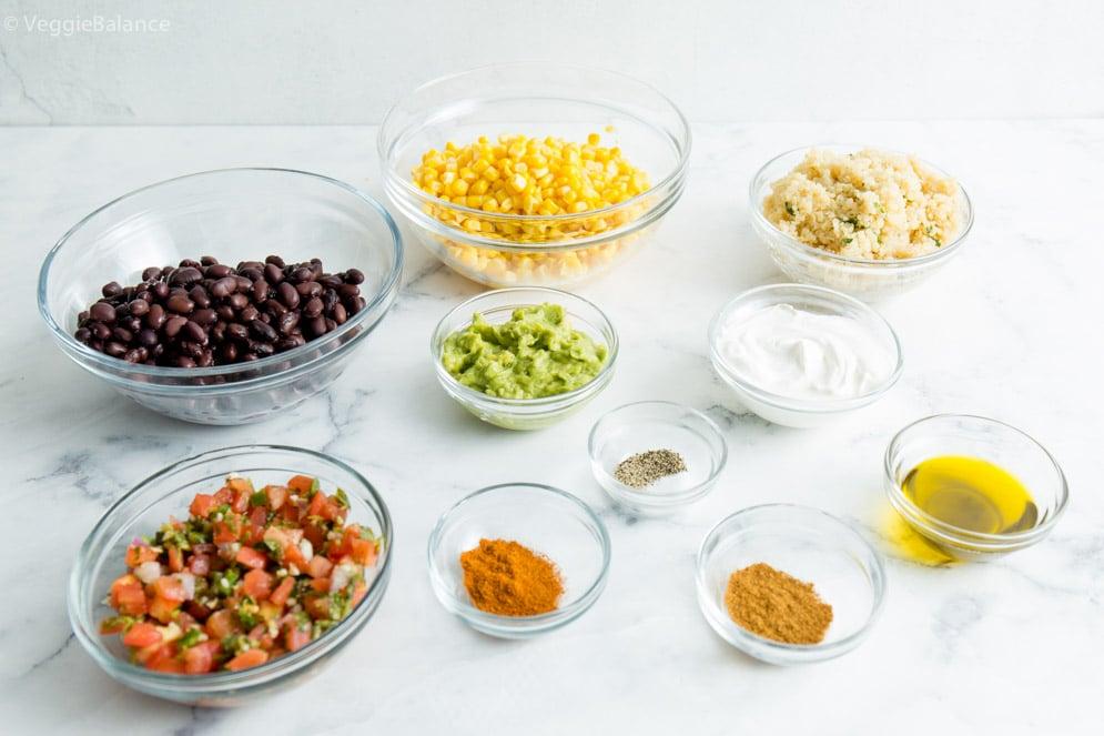 All the ingredients you'll need for our vegan burrito bowl: Black beans, Corn, Guacamole, Cilantro Lime Quinoa, Pico de gallo