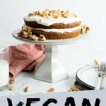 "PINTEREST IMAGE with words ""Vegan Carrot Cake"" Vegetarian Carrot Cake on a white cake stand."