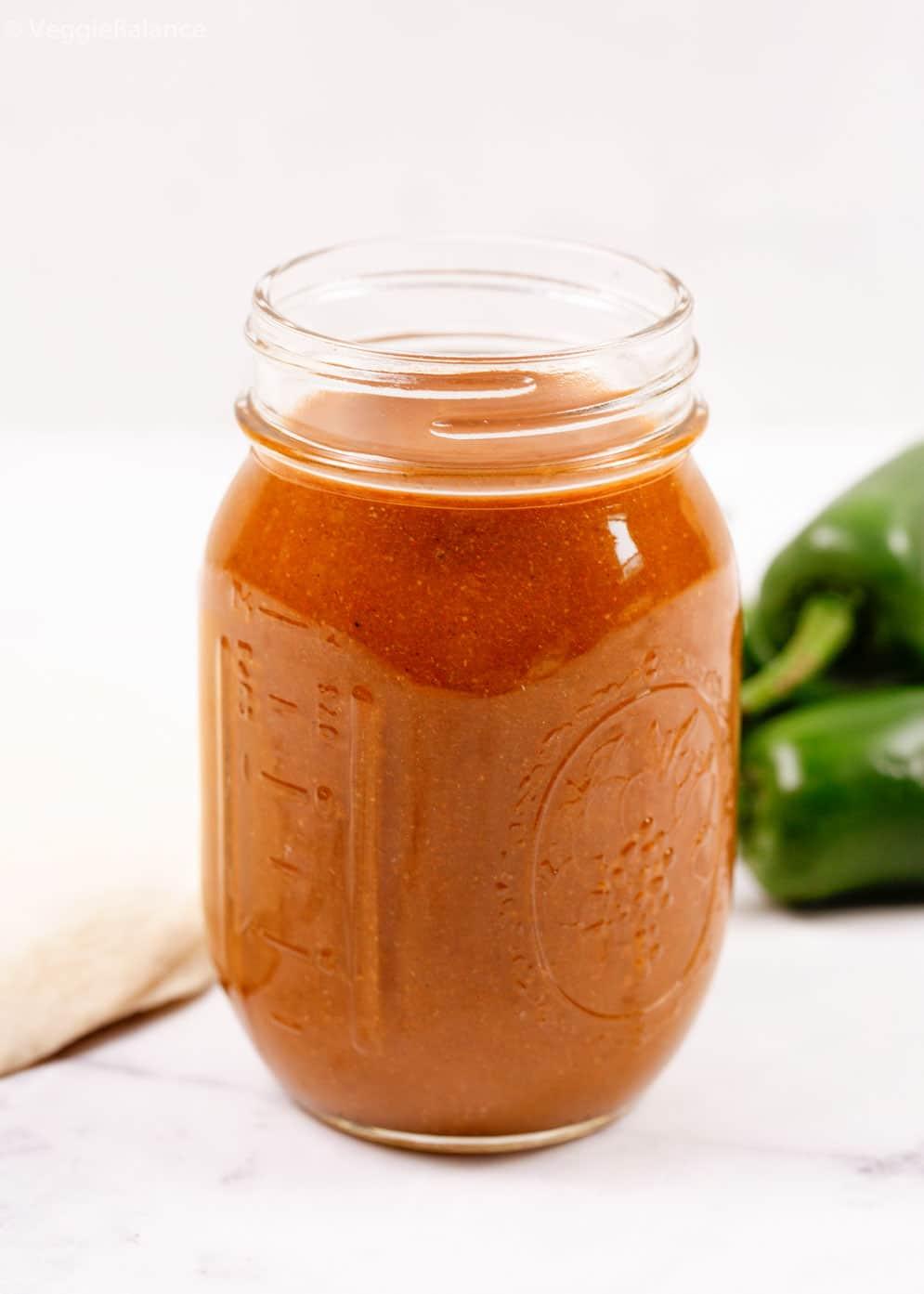 Homemade Red Enchilada Sauce in glass mason jar