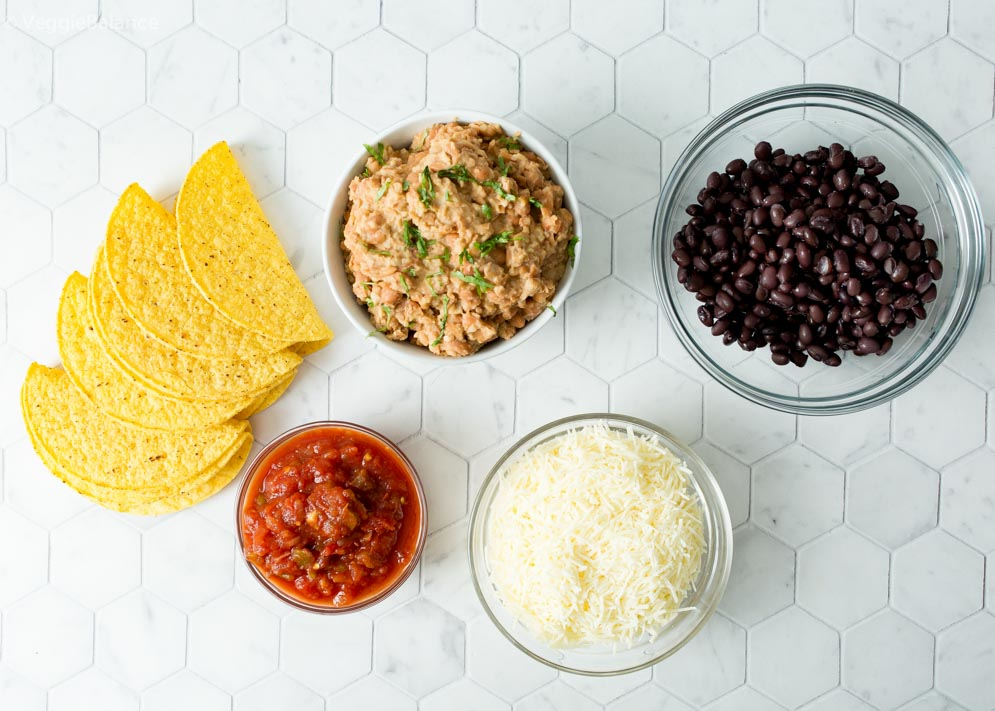 Overhead shot of ingredients needed to make baked refried bean tacos