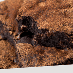 "PINTEREST IMAGE with words ""Plant Based Fudgy Brownies"" Image of Easy Vegan Brownies piled with a bite taken out of one."