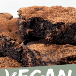 "PINTEREST IMAGE with words ""Vegan Brownies"" Image of Easy Vegan Brownies piled with a bite taken out of one."