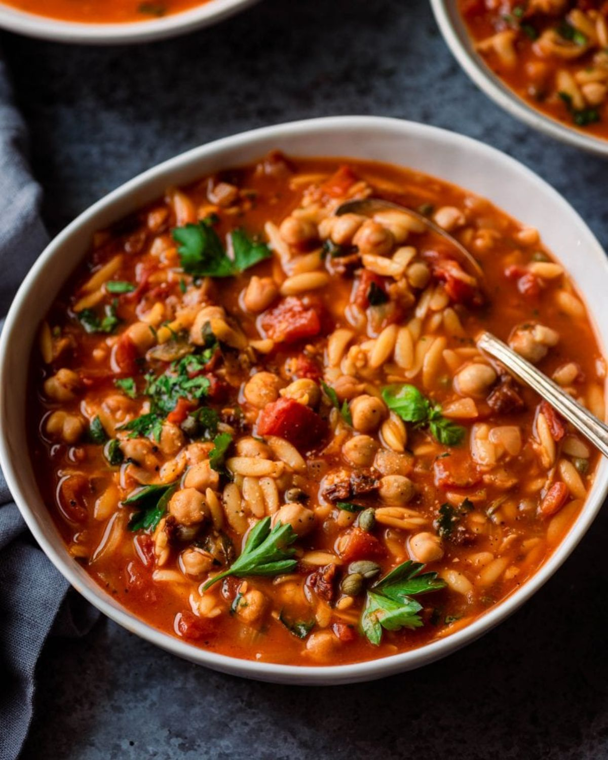 a bowl full of chickpea orzo soup
