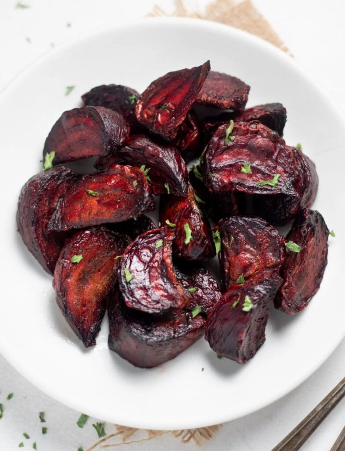 a white plate filled with roasted beets