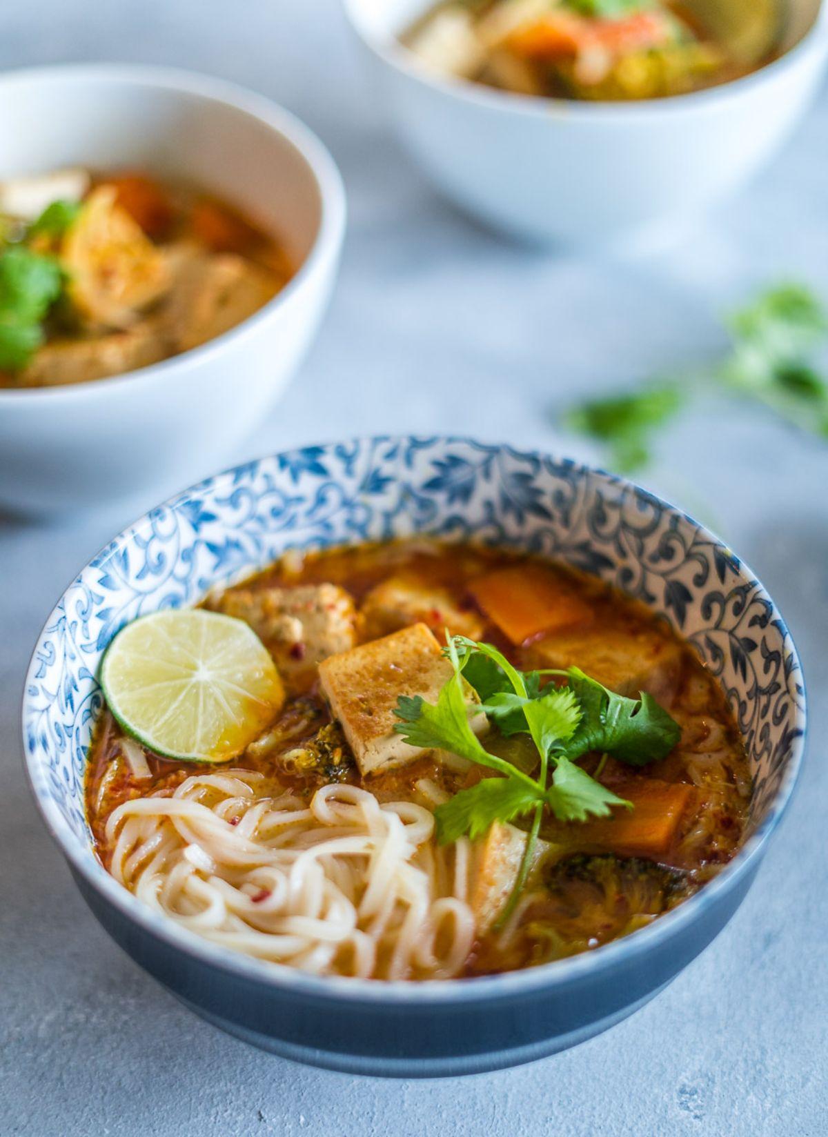 3 bowls full of thai coconut noodle soup