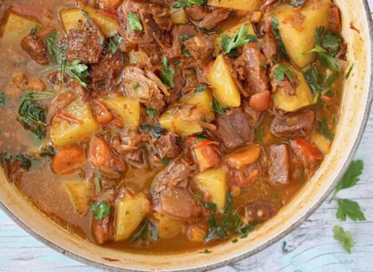 a close up of a cast iron casserole dish full of jackfruit stew