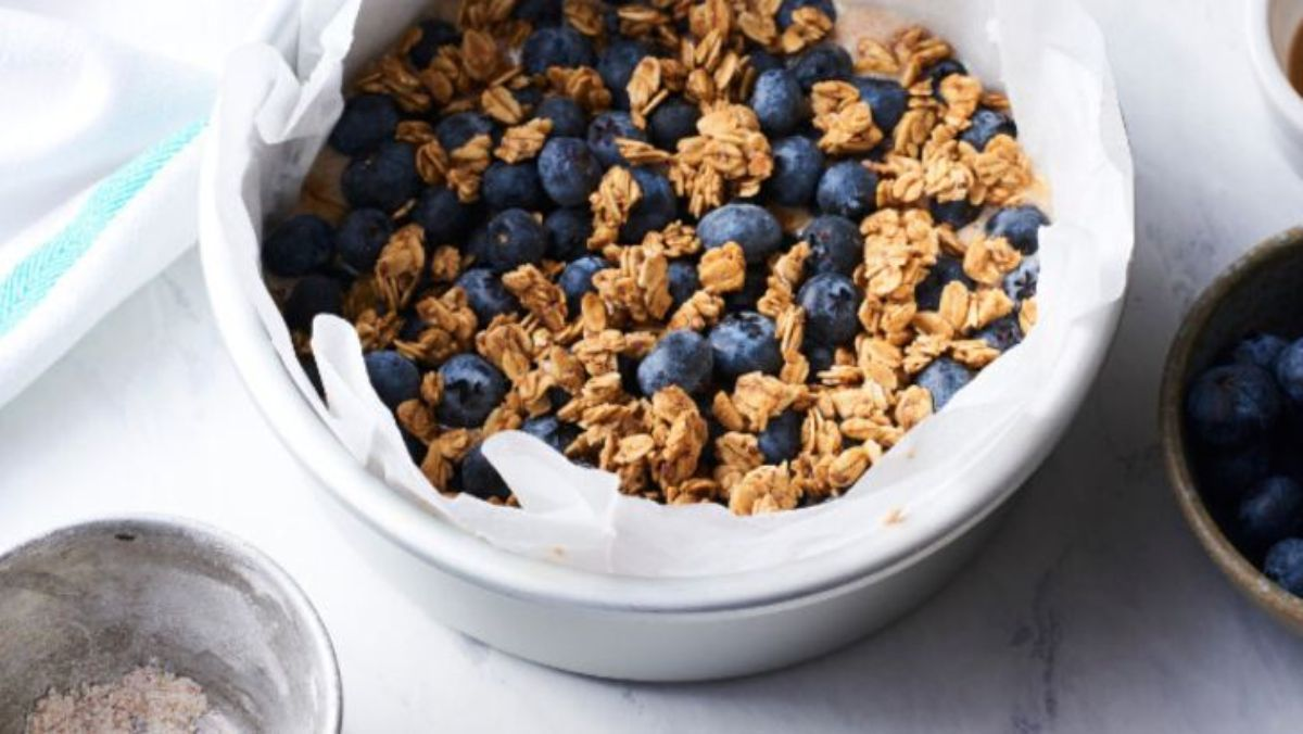 a bowl of granola with blueberries